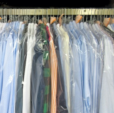 clothes on rail in plastic laundry bags